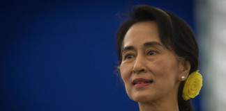 Aung San Suu Kyi Calls for Stricter Business Regulation